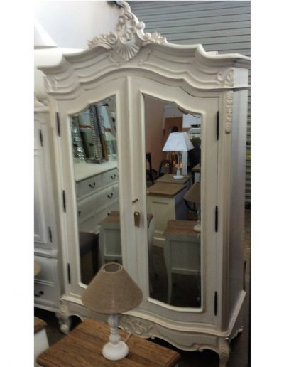 white armoire carved - panel mirror doors